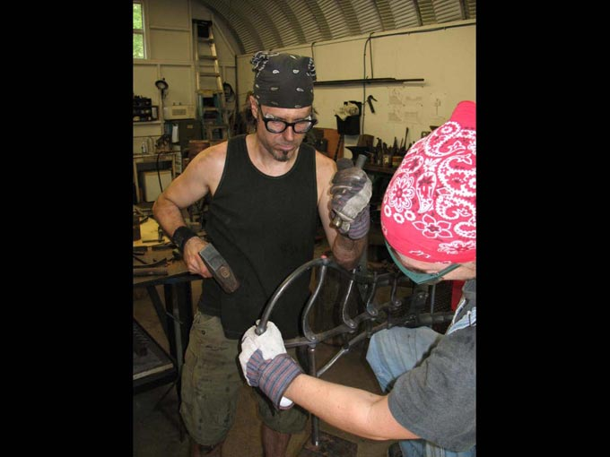 Chris Shea making a forged chair: All tenons and rivets must be hammered down hot to set each joint